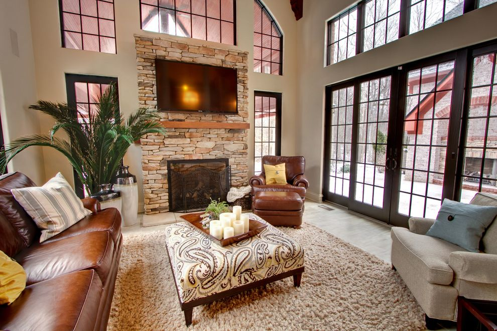 Kegerator Sams Club with Traditional Family Room Also Arched Window Area Rug Beige Brown Leather Club Chair Fire Screen Fireplace Large Windows Paisley Ottoman Stacked Stone Wall Mount Tv Yellow