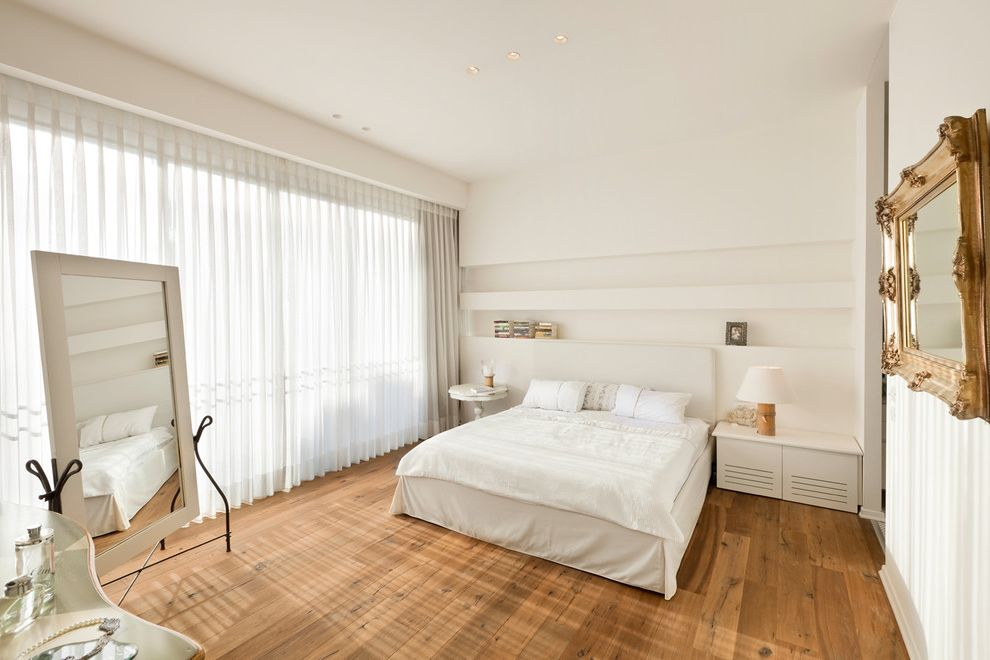 Kempas Hardwood Flooring   Traditional Bedroom  and Airy Bedskirt Bright Built in Shelves Full Length Mirror Gold Frame Hardwood Floors Sheer Curtains Simple Table Lamp White