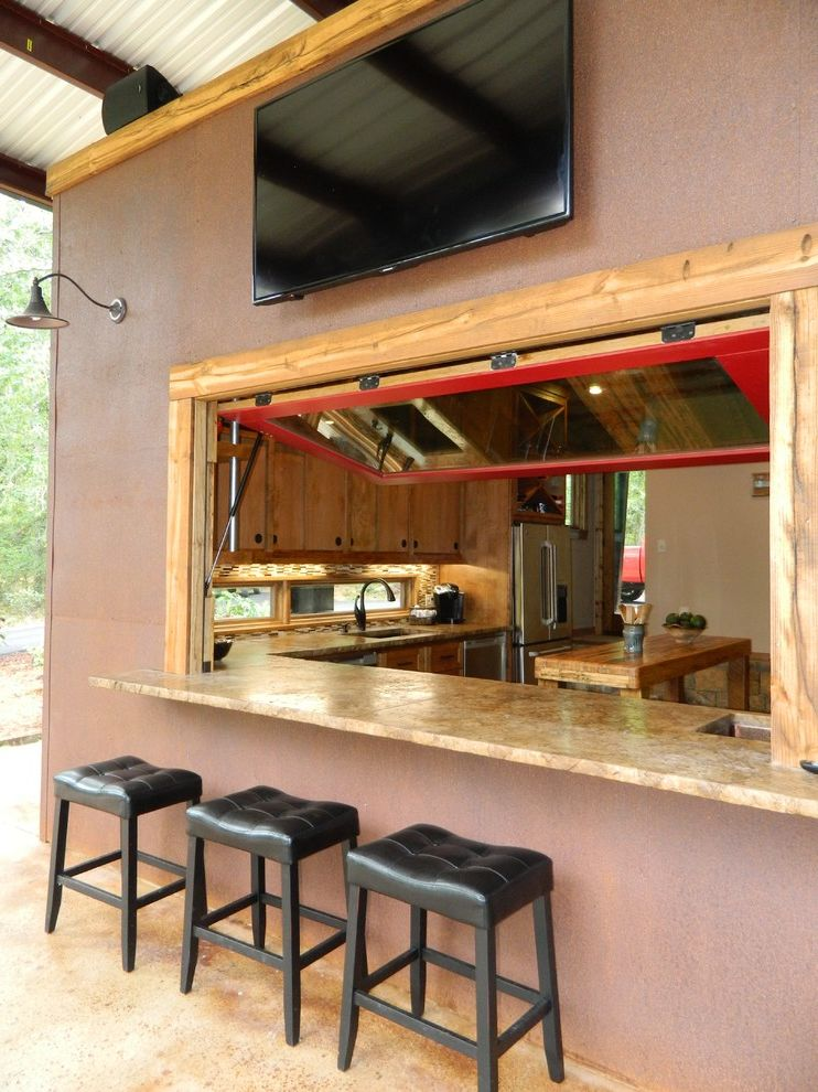 Kess in House with Rustic Patio Also Concrete Counters Cor Ten Steel Gooseneck Lamp Hydraulic Window Leather Barstools Outdoor Bar Outdoor Tv Pella Windows Plasma Red Window Rust Rustic Stained Concrete Floor