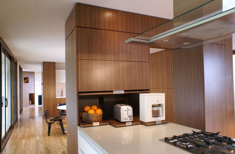 Kettle Moraine Appliance with Modern Kitchen  and Appliance Garage Gas Cooktop Island Hood Walnut Cabinetry