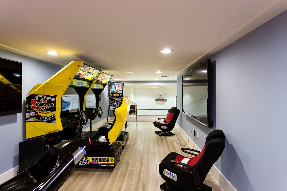 Kid Picks Game   Contemporary Family Room Also Arcade Games Basketball Hoop Flat Screen Tv Game Room Gamer Chair Gaming Chair Gray Wall Kids Game Room Kids Room Pinball Machine Play Room Video Game Console Video Game Room Video Games Wood Floor