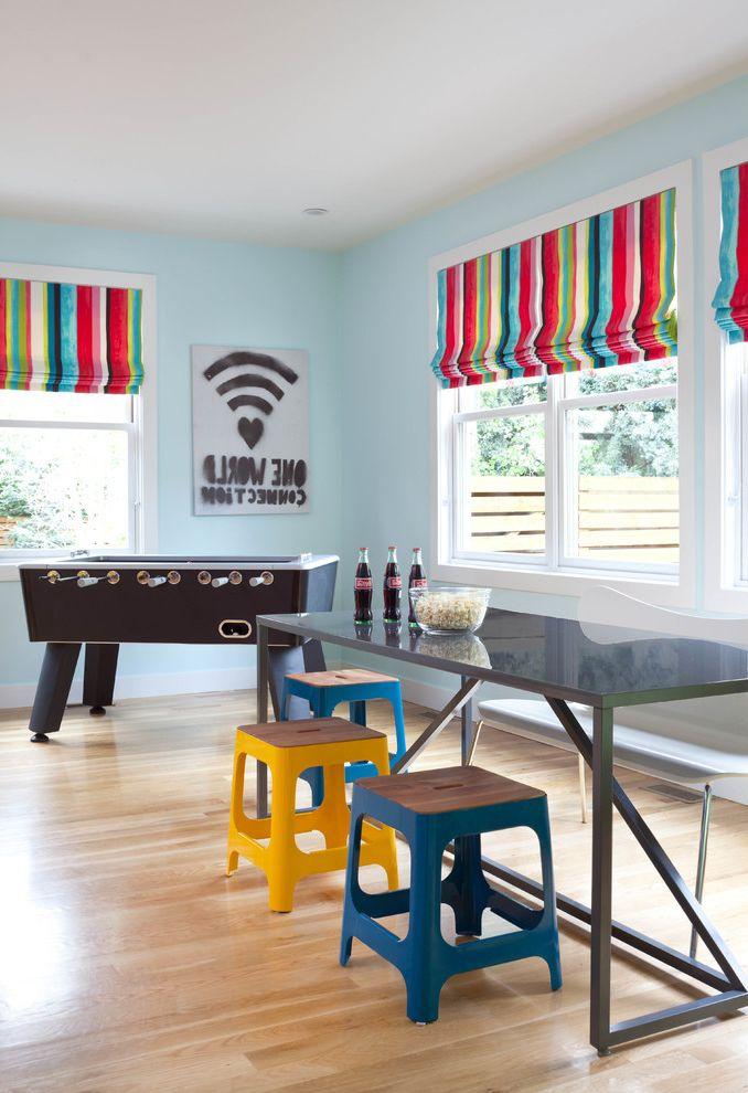 Kid Picks Game   Contemporary Family Room  and Blue Stool Colorful Foosball Gray Table Stools Striped Roman Shades Wall Art Windows Yellow Stool