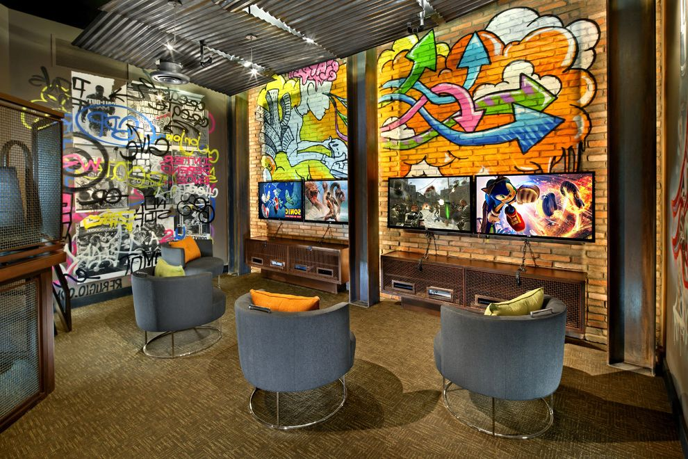 Kid Picks Game   Contemporary Home Theater  and Art Bright Colors Ceiling Corrugated Metal Ceiling Custom Flatscreen Gaming Room Graffiti Art Gray Chairs Kds Interiors Man Cave Media Media Credenza Mens Space Multiple Tvs Olive Carpet Orange Pillows Tv