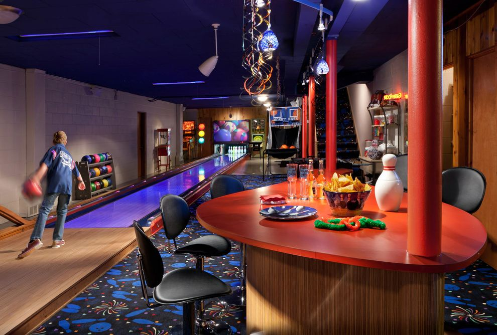 Kid Picks Game   Eclectic Basement Also Black Counter Stool Black Pendant Light Bowling Bowling Balls Carpet Pattern Carpeted Floor Family Room Game Room Kids Room Orange Beam Orange Countertop Orange Post Wood Floor
