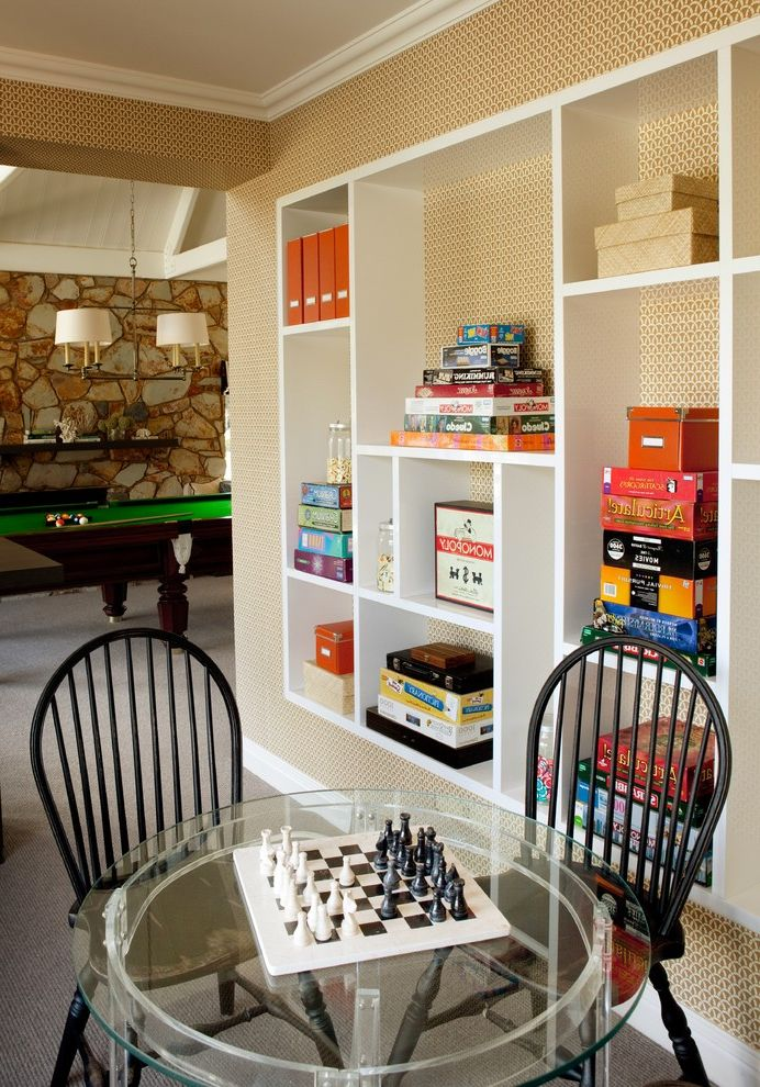 Kid Picks Game   Traditional Family Room  and Built in Shelves Custom Shelves Game Room Interior Wallpaper Lucite Table Pendant Lighting Pool Table Stone Wall White Baseboards Windsor Chairs