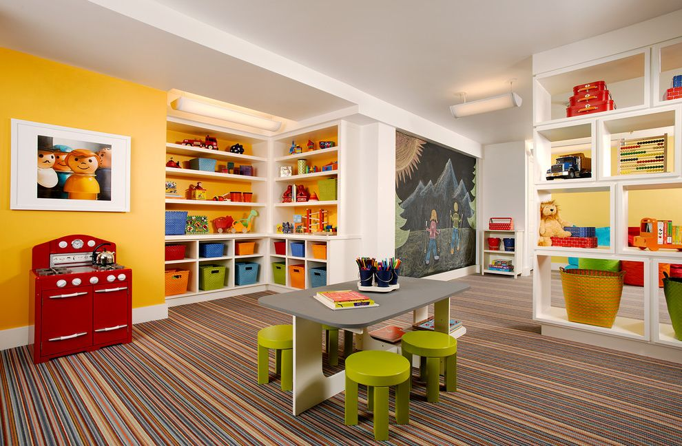 Kid Picks Game with Traditional Kids  and Baseboards Basement Built in Shelves Built in Storage Ceiling Lighting Chalkboard Wall Gold Walls Kids Furniture Playroom Storage Bins Striped Rug White Wood Wood Trim Yellow Walls