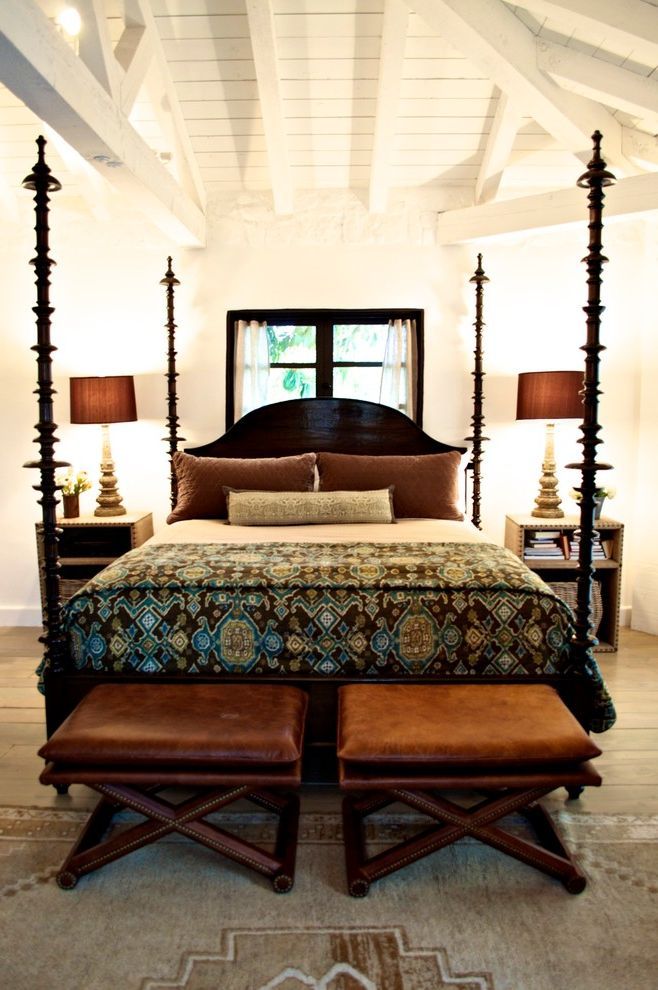 King Bed Spreads with Mediterranean Bedroom Also Beige Rug Dark Wood Window Casement Exposed Beams Exposed Truss High Ceiling Leather Bench Light Wood Floor Neutral Colors Sheer Curtains White Ceiling White Walls Wooden Four Poster Bed