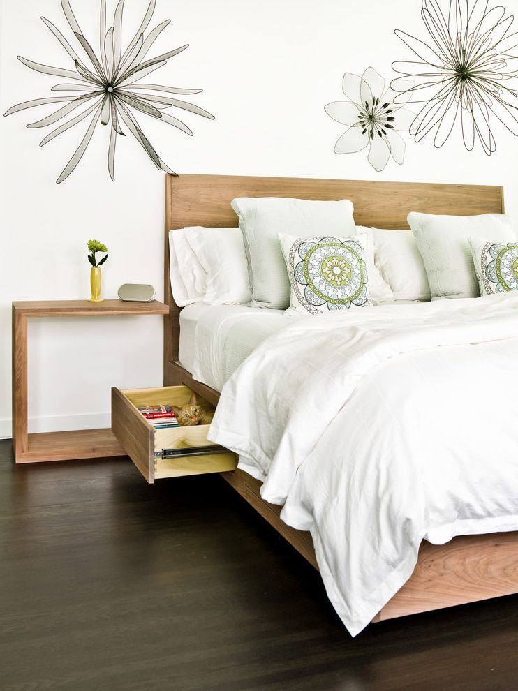 King Size Sleep Number Bed   Contemporary Bedroom  and Bedding Bedroom Bedroom Furniture Dark Hardwood Floors Floral Neutral Colors Nightstand Pillows Storage Bed Storage Drawers Wall Art White Wall Wood Bed Wood Headboard