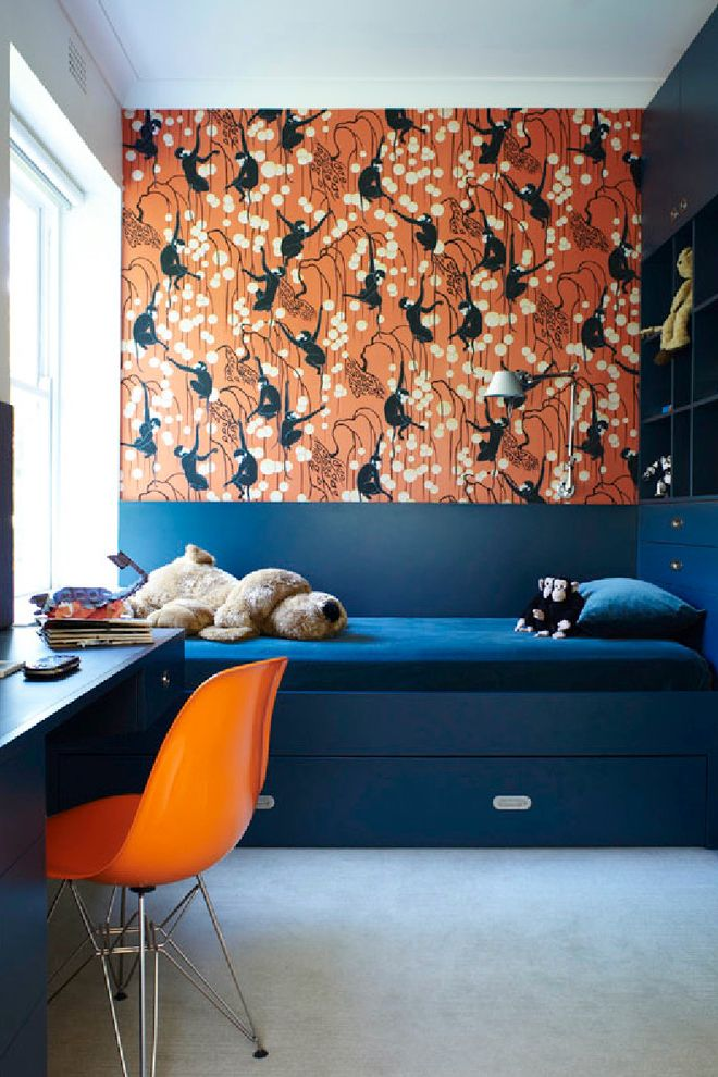 King vs Cal King with Contemporary Kids Also Blue Painted Cabinets Built in Cubbies Carpeting Dark Blue Daybed Desk Navy Orange Desk Chair Plush Toys Reading Light Under Bed Storage Wall Sconce Wallpaper
