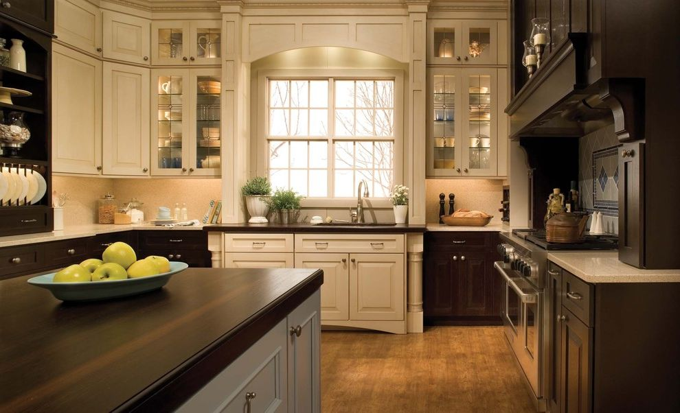 Kitchen and Bath Showrooms Near Me with Traditional Kitchen  and Cabinet Design Cabinetry Dark Wood Decorative Tile Dura Supreme Dura Supreme Cabinetry Glass Front Cabinets Hardwood Floors Hood Kitchen Island Oven Surround Plate Rack White Cabinets