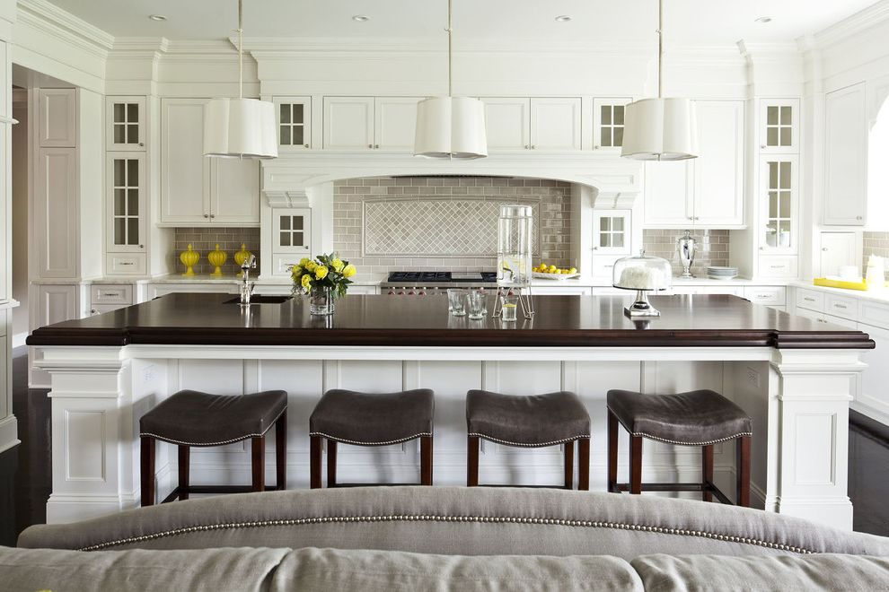 Kitchen Design Stores Near Me   Transitional Kitchen  and Black Floors Brown Cabinetry Chandelier Dark Wood Family Gray Martha Ohara Interiors Modern Nail Heads Over Size Island Stools Tile White White Kitchen Wood Top Island Yellow