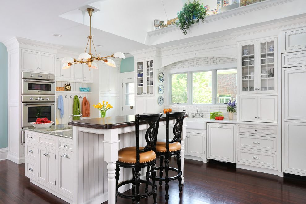 Kitchen Remodel Las Vegas with Traditional Kitchen  and Apron Sink Bar Stools Beadboard Cambria Classic Heart Pine Floors Island Sink Light Fixture Mud Room Pine Floors Row of Windows Vaulted Ceilings Victorian Home Walnut Breakfast Bar White Kitchen
