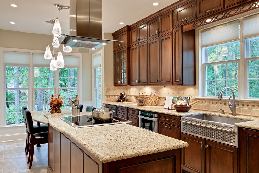 Kitchen Sink St Louis with Traditional Kitchen Also Farm Sink Fretwork Glass Hood Granite Granite Counters Lighting Microwave Drawer Pendant Lights Stained Cabinets Stainless Farm Sink Stainless Steel Hood