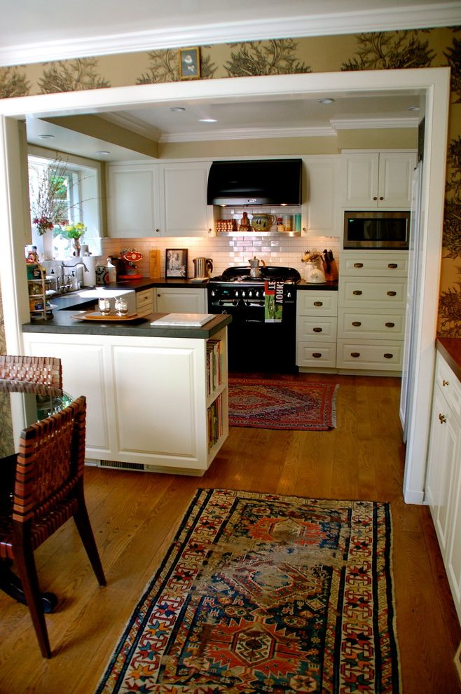 Kitchen Slice Rugs with Traditional Spaces  and Area Rug Bookshelves Cookbook Shelf Galley Kitchen Hardware Kitchen Shelves Oriental Rugs Range Hood Tile Backsplash Wallcoverings Wallpaper White Cabinets White Wood Wood Cabinets Wood Flooring Wood Trim