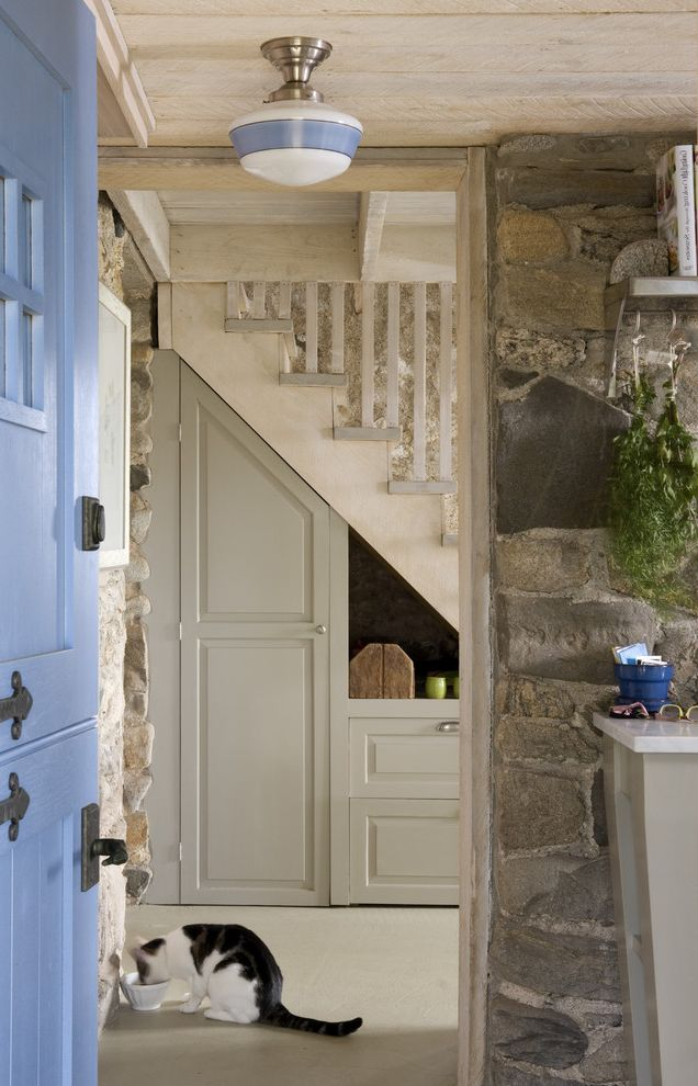 Knickerbocker Pools with Rustic Entry  and Cottage Dutch Door Periwinkle Door Rustic Schoolhouse Sconce Soft Jazz by Benjamin Moore Stone Wall Under Stairs Storage Wood Ceiling