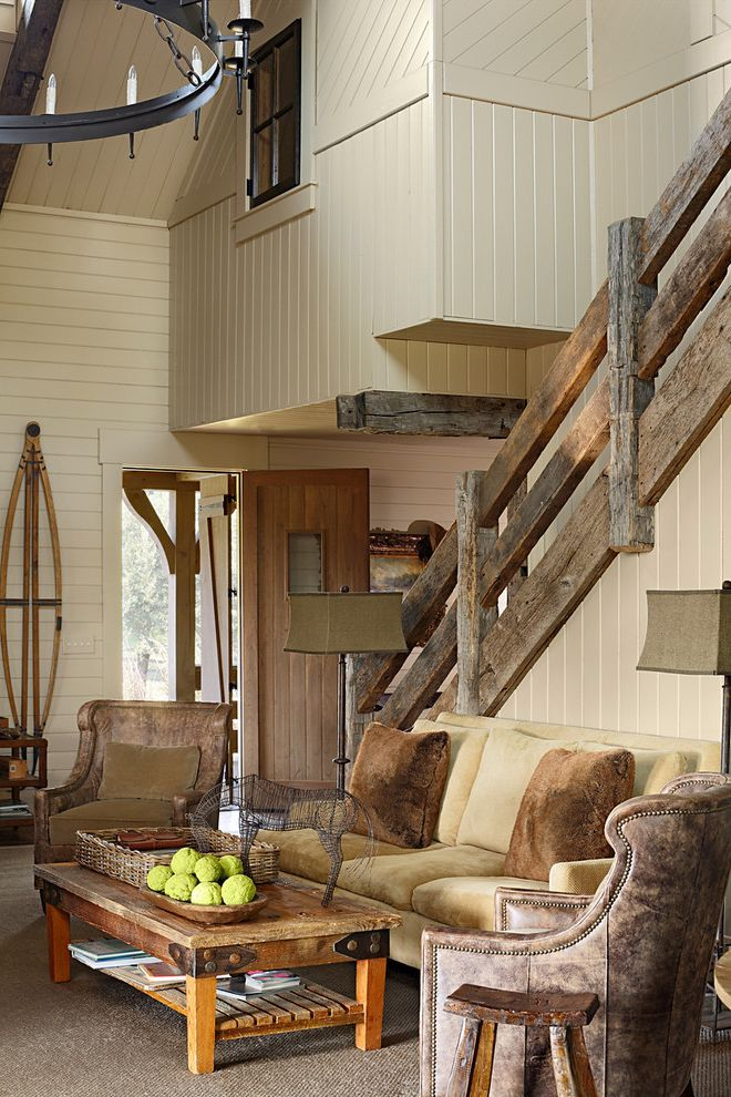 Knox Rail Salvage with Rustic Living Room  and Area Rug Earth Tone Colors Entrance Entry Leather Armchair Monochromatic Nail Head Trim Neutral Colors Rustic Tongue and Groove Wood Paneling Wood Railing