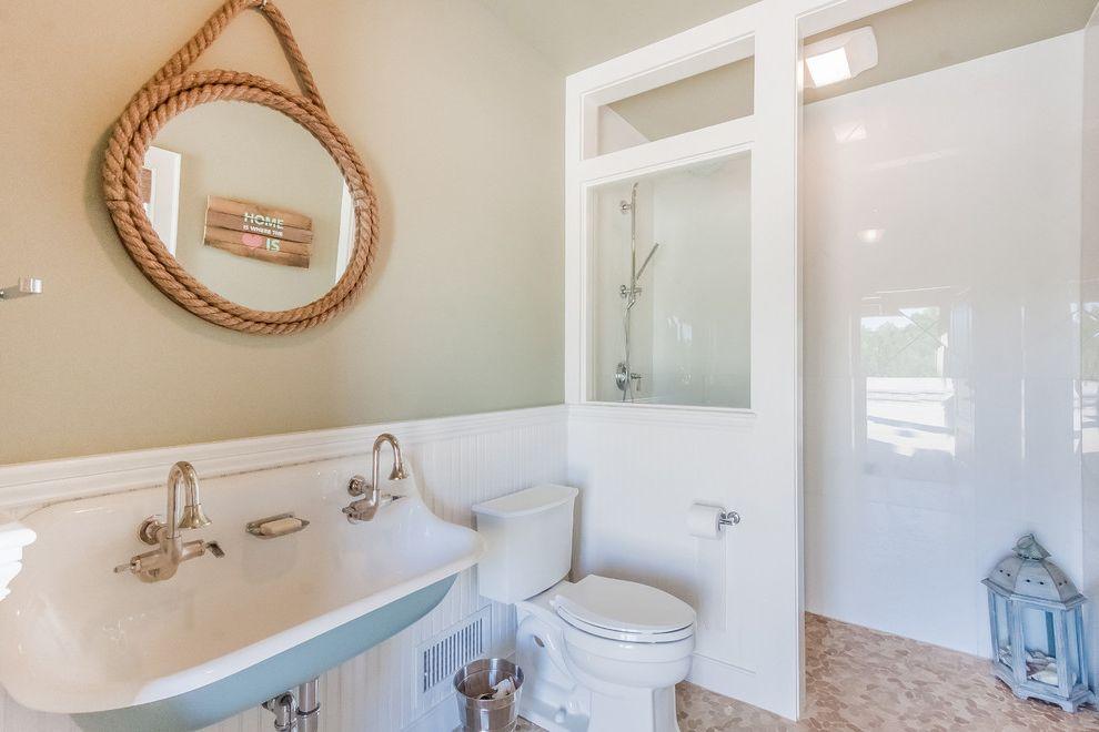 Kohler K 2210 0   Beach Style Bathroom  and Cabana Bath Craftstman Double Sink Lantern Mosaic Tile Floor Open Shower Paneling Pebble Tile Pool House Bathroom Rope Mirror Shower Tile Shower Tub Sink Wainscoting Window in Shower