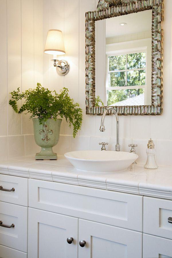 Kohler K 2210 0   Traditional Bathroom Also Pewter Hardware Sconces Shell Mirror Tile Countertop Vessel Sink White Shaker Cabinetry Wood Paneling