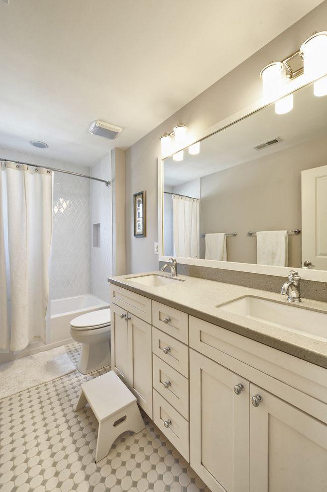 Kohler K 2210 0   Traditional Bathroom  and Bathroom Stool Double Sinks Double Vanity Floor Tile Kitchen Hardware Monochromatic Sconce Shaker Style Shared Bathroom Shower Curtains Shower Tub Wall Lighting White Bathroom White Cabinets