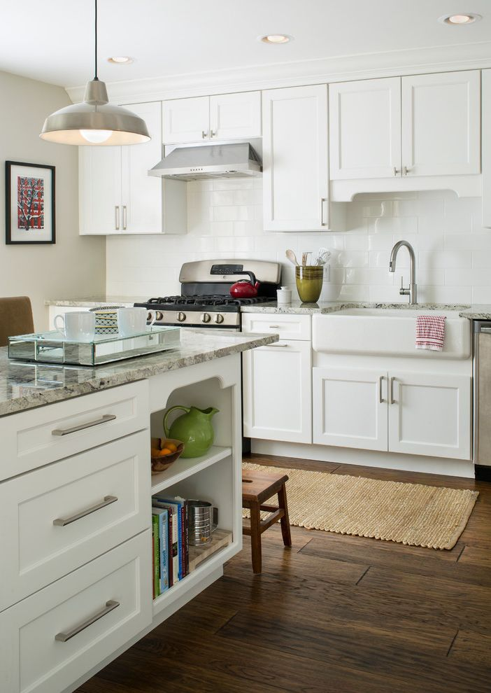 Kohler K 2210 0 with Farmhouse Kitchen  and Cookbook Storage Gray Countertop Open Shelves Pendant Light Recessed Lighting Wood Stool