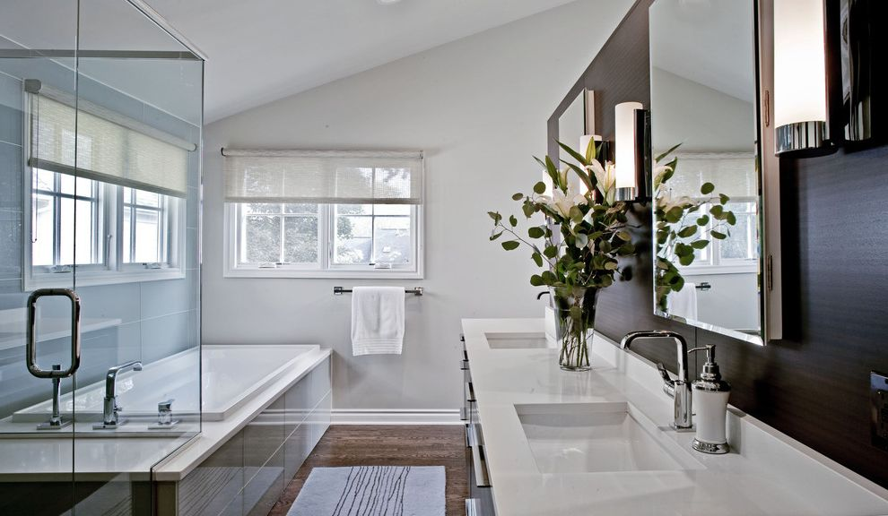 Kohler K 2215   Contemporary Bathroom  and Baseboards Bathroom Mirror Dark Wall Double Sinks Double Vanity Glass Shower Enclosure Neutral Colors Shared Bathroom Sloped Ceiling Soaking Tub Square Sinks Vaulted Ceiling Window Treatments