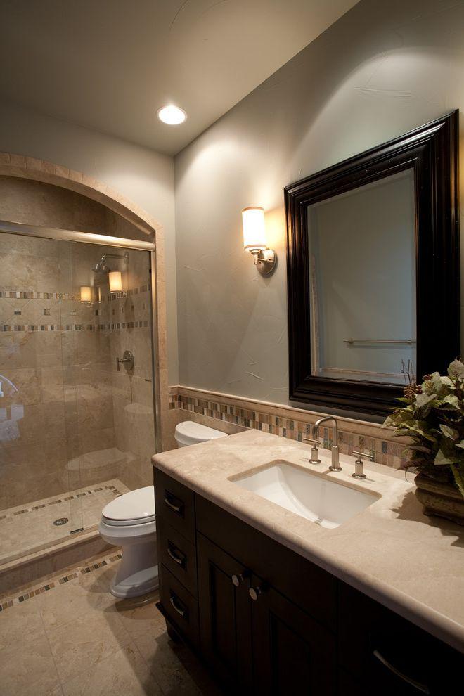 Kohler K 2215   Traditional Bathroom Also Accent Tile Dark Wood Cabinetry Framed Mirror Glass Shower Door Glass Tiles Grey Wall Mosaic Tiles Sconce Tile Trim Undermount Sink Vanity Wall Lighting Wall Mirror