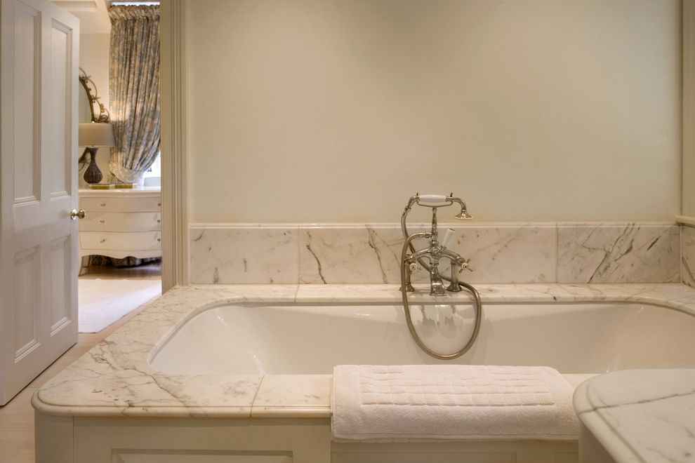 Kohler Tub Surround   Traditional Bathroom  and Bath Fixtures Bath Hardware Marble Tile Monochromatic Neutral Colors Soaking Tub Tub Surround White Bathroom