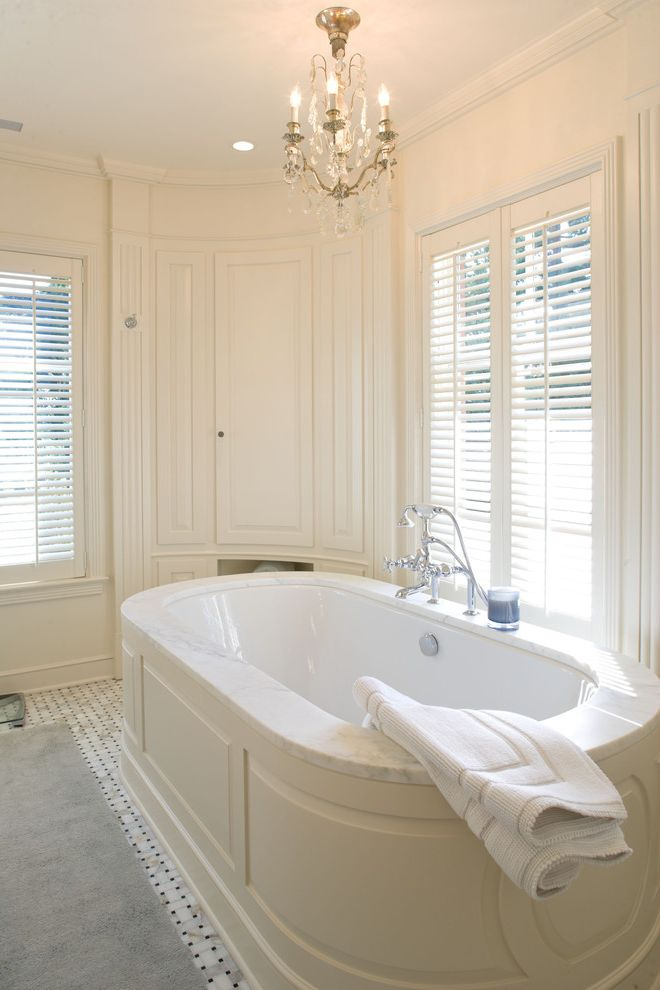 Kohler Tub Surround with Contemporary Bathroom Also Bathtub Built in Cabinet Carpet Runner Chandelier Corner Cabinet Curved Cabinet Fluted Woodwork Louvers Marble Deck Shutters Soaking Tub Tile Floor White White Walls Wood Tub Surround