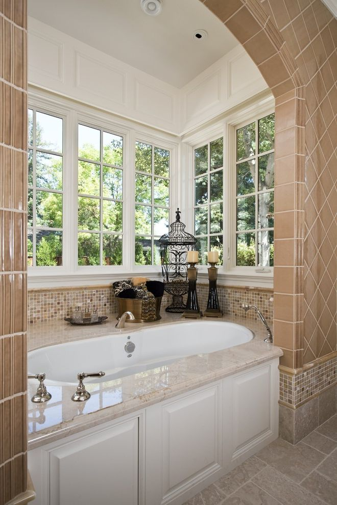 Kohler Tub Surround with Traditional Bathroom  and Bath Accessories Bay Window Candle Holder Candles Ceiling Lighting Glass Tiles Lantern Marble Marble Surround Mosaic Tiles Neutral Colors Nook Soaking Tub Tile Trim Tub Surround Wainscoting Wall Tiles