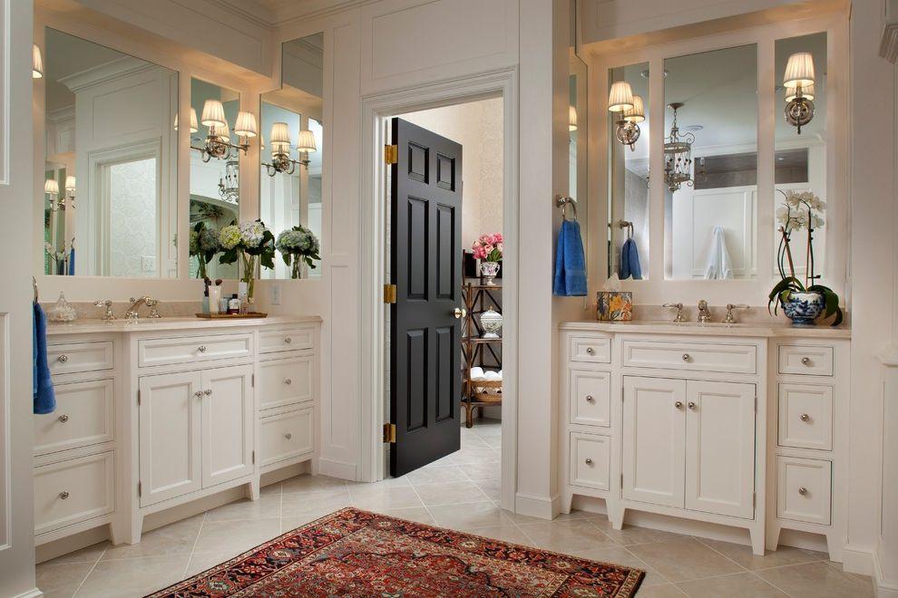 Kohler Villager Tub with Traditional Bathroom  and Black Door Mirror Oriental Carpet Sconces Tiled Floor Vanity White White Vanity