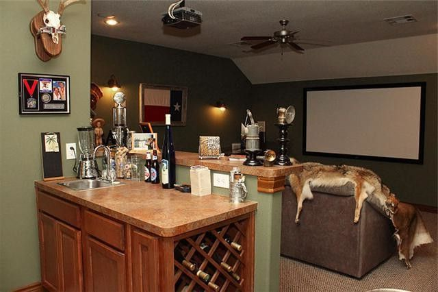 Kurk Homes   Traditional Home Theater  and Granite Pub Wine Rack