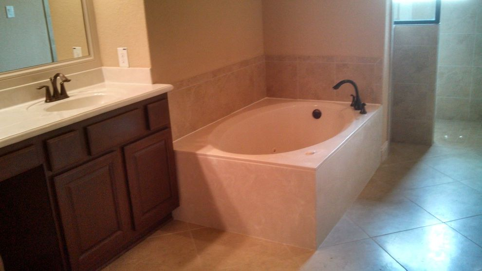 Kurk Homes with Traditional Bathroom Also Dark Cabinetry Garden Tub Master Bath Oversized Tub