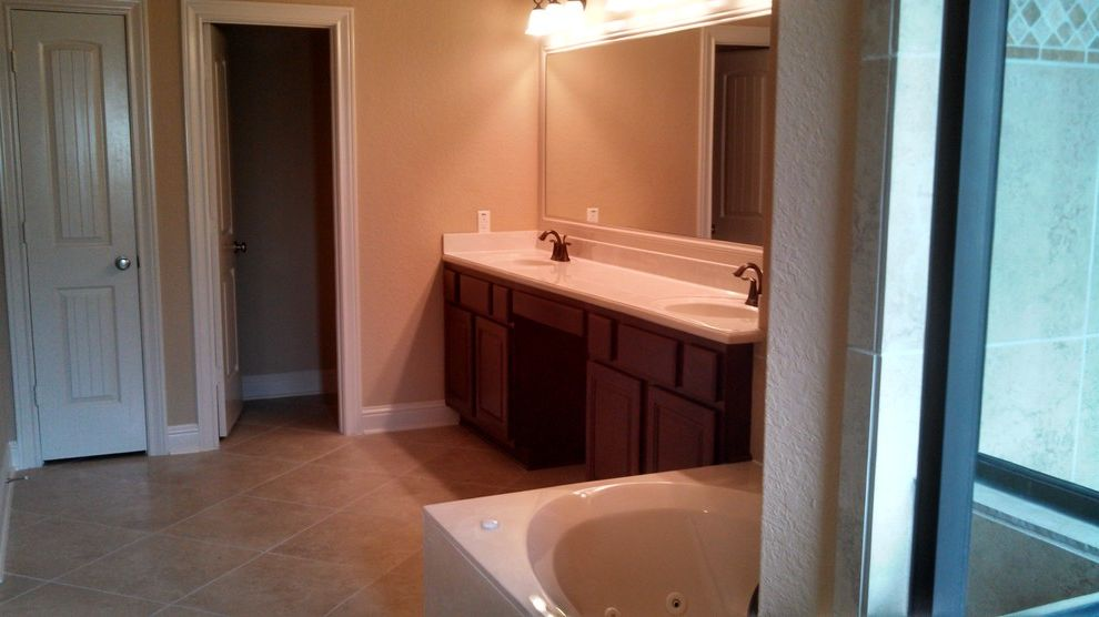 Kurk Homes with Traditional Bathroom  and Dark Cabinetry Oversized Tub Tile