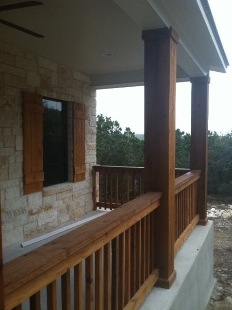 Kurk Homes with Traditional Porch Also Cedar Porch Cedar Posts Cedar Shutters Hill Country Stone Texas