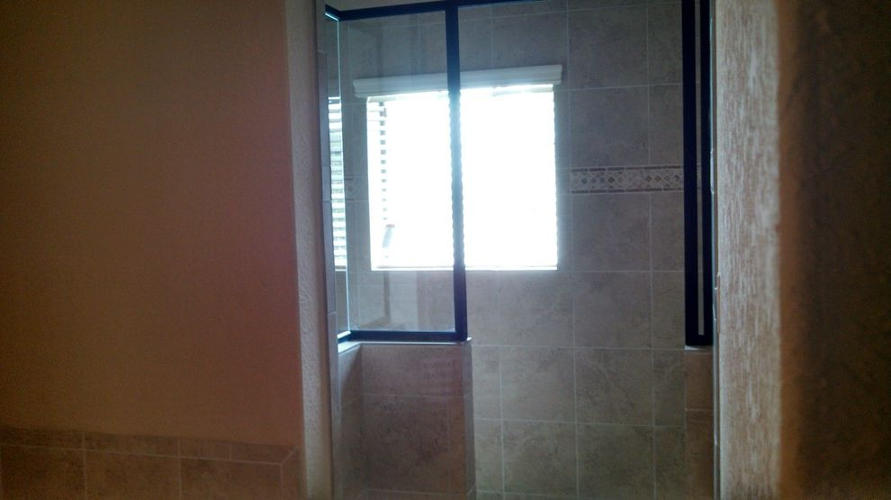 Kurk Homes with Traditional Spaces  and Backsplash Tile Walk in Shower