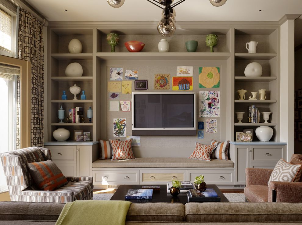Ky Touch Review   Transitional Family Room  and Beige Cabinets Beige Shelves Built in Bench Built in Cabinets Chandelier Folding Doors Folding Windows Patterned Armchair Patterned Drapes Tall Drapes Wall Art Wall Mounted Tv