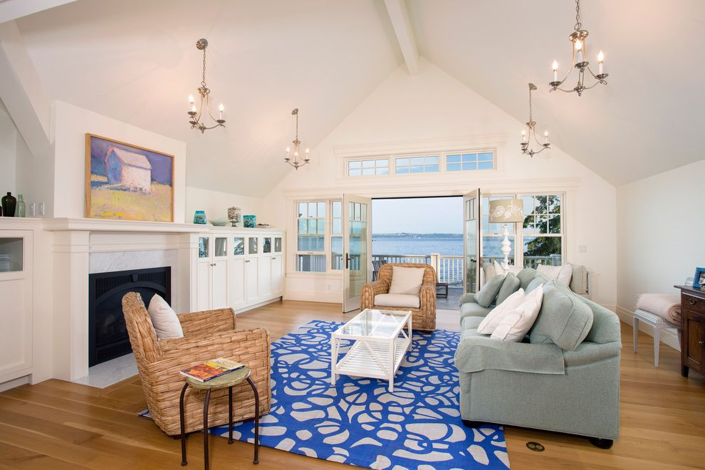 La Gorce Country Club   Beach Style Family Room Also Blue Area Rug Blue Sofa Built in Cabinets Cathedral Ceiling Chandelier Clerestory Window Custom Built Millwork Oak Floors