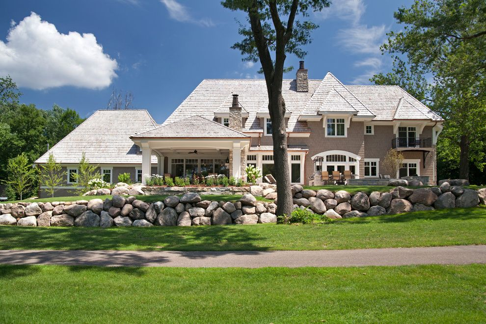 La Gorce Country Club with Traditional Exterior  and Cedar Country Club Dormers Exterior Fire Pit Firepit Golf Course Hip Roof Interlachen Landscaping Lawn Path Patio Shakes Shingles Sidewalk Stone Stone Chimney Stone Walls White Trim