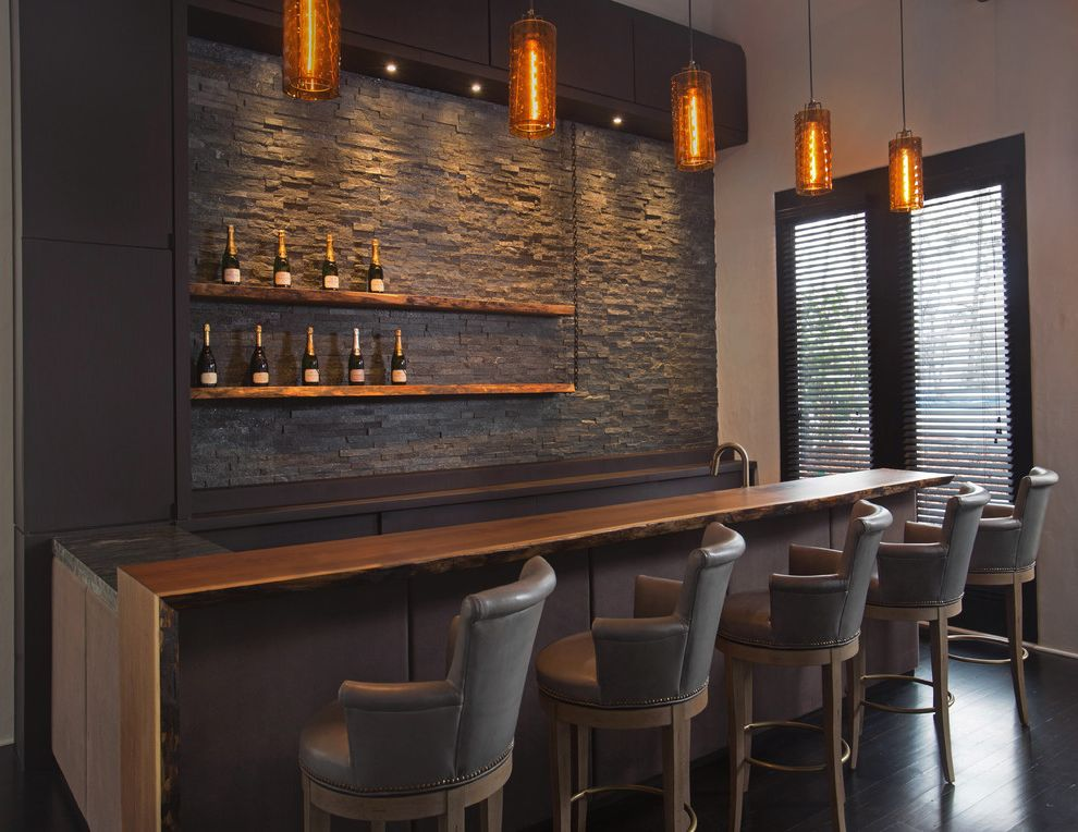 La Gorce Country Club with Transitional Home Bar  and Backed Bar Stools Custom Bar Floating Shelves Leather Panels Live Edge Orange Pendant Light Reclaimed Wood Splitfaced Stone Stone Backsplash Transitional Walnut Wood Countertop