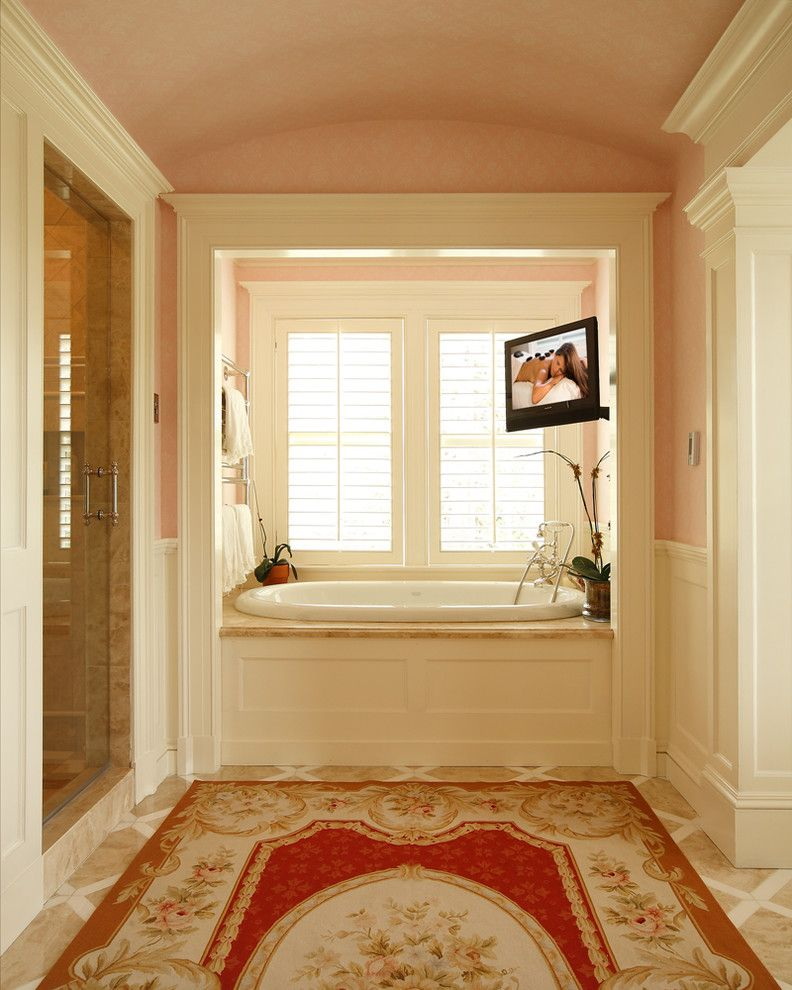 La Gorce Country Club with Victorian Bathroom  and Barrel Vaulted Ceiling Crown Molding Floor Tile Pattern Floral Area Rug Glass Shower Door Oval Tub Tub Alcove Wall Mounted Tv White Wainscoting Window Shutters