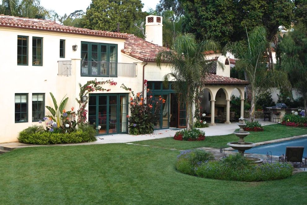 La Habra Stucco   Mediterranean Exterior Also Arched Loggia Balcony Door Trim French Doors Grass Landscape Landscaping with Pool Outdoor Dining Outdoor Furniture Painted Trim Palm Trees Patio Pool Tile Roof Window Trim