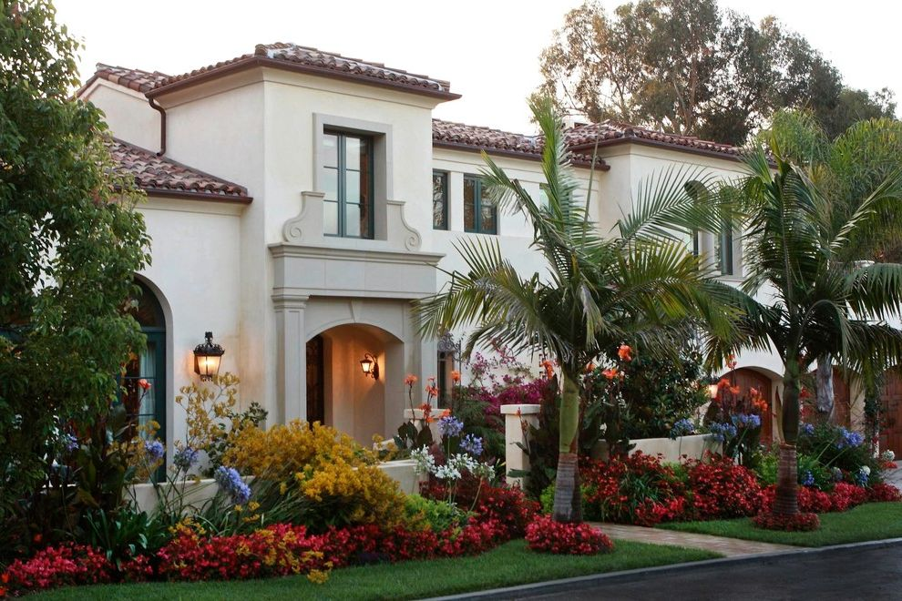 La Habra Stucco with Mediterranean Exterior Also Arched Entry Bright Colors Entry Courtyard Exterior Lighting Flowers Landscape Palm Trees Planting Tile Roof Window Trim