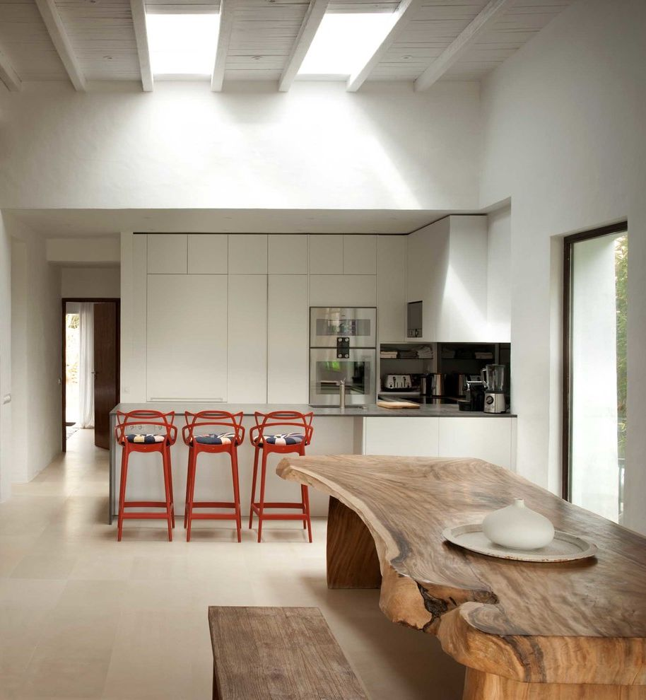 La Mesa Omaha with Mediterranean Kitchen Also Exposed Beams Ibiza Ibiza House Luxury Luxury Ibiza Natural Edge Wood Raw Edge Wood Red Bar Chairs Skylights Summer Home Wood Bench