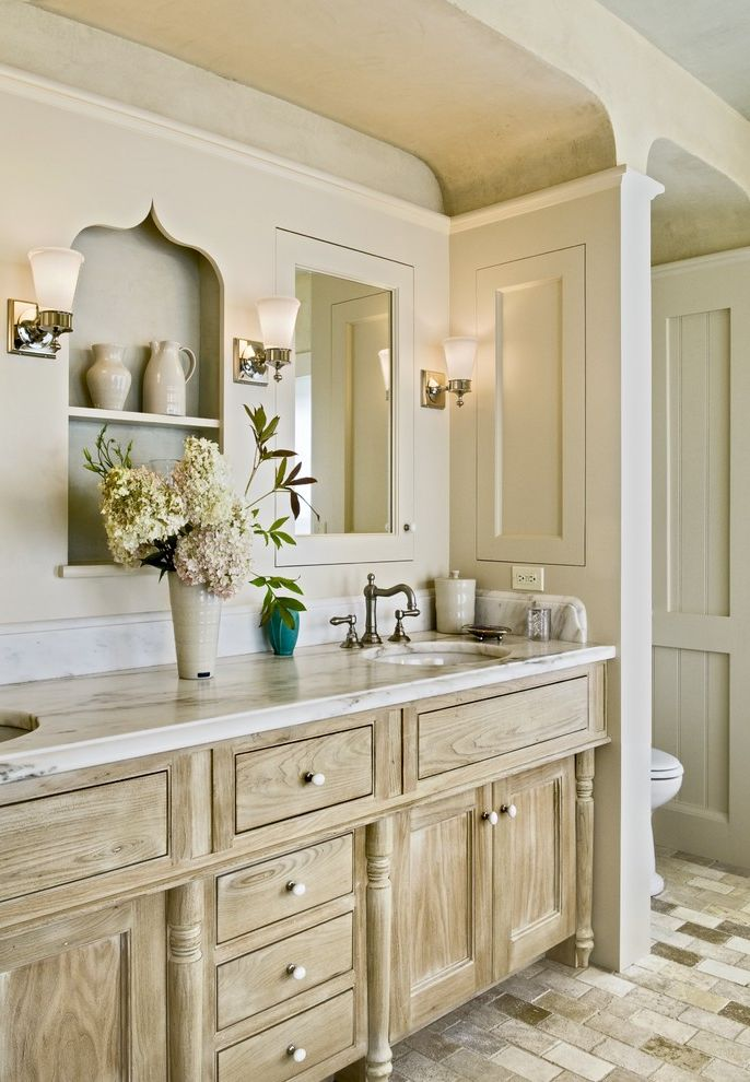 Lakeside Natural Medicine with Traditional Bathroom  and Built Ins Distressed Finish Cabinets Double Sinks Double Vanity Limestone Floors Marble Countertops Medicine Cabinet Recessed Shelves Sconce Shared Bathroom Stone Tile Floors Wall Lighting