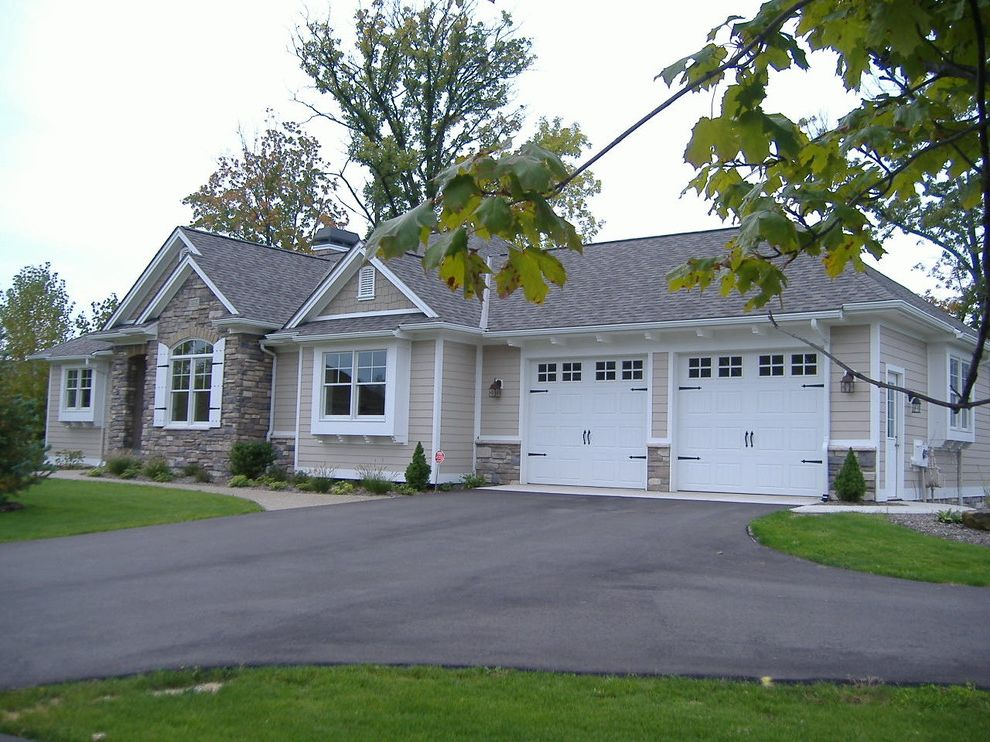 Landmark Weathered Wood   Traditional Exterior Also and Cottage Style Windows Cement Fiber Siding Plenty of Gable Roof and Returns Shake Siding Stone
