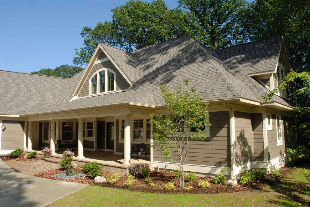 Landmark Weathered Wood   Traditional Exterior Also Arch Window Arched Windows Cement Board Front Doors Front Porch James Hardie Pella Porch Side Load Garage Water Feature