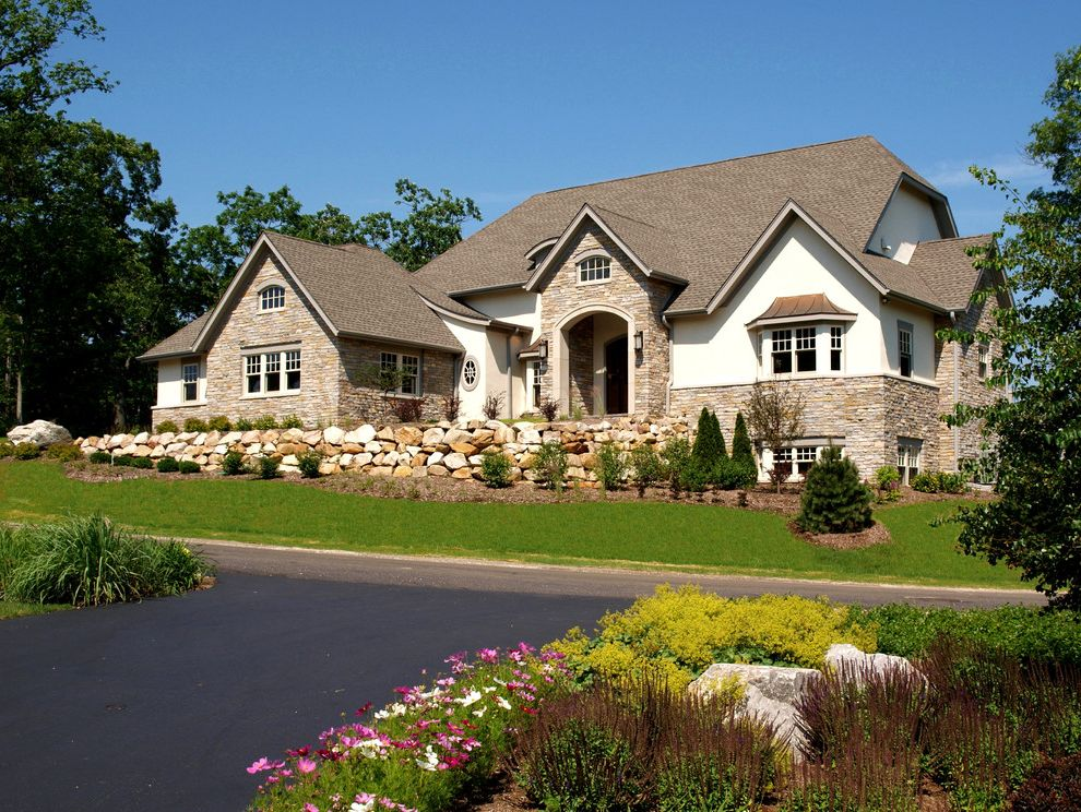 Landmark Weathered Wood with Traditional Exterior Also Arched Opening Arched Window Grass Landscaping Lawn Shingle Roof Stone Wall
