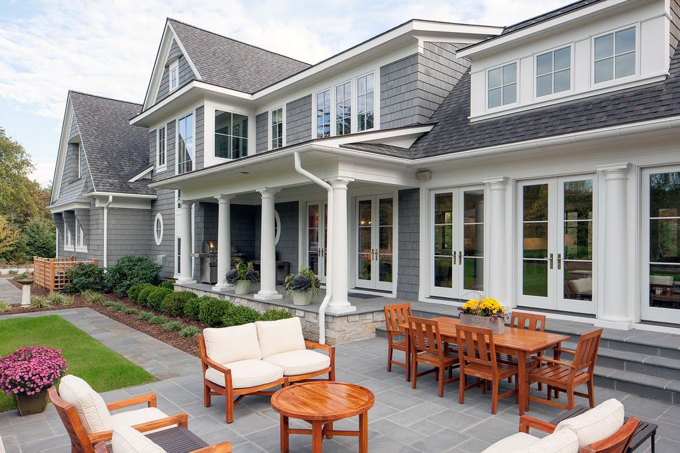 Landmark Weathered Wood with Traditional Patio Also Covered Porch Dormer French Doors Gray Exterior Outdoor Dining Outdoor Furniture Shingle Siding Slate Pavers Stained Wood Stone Pavers White Casing