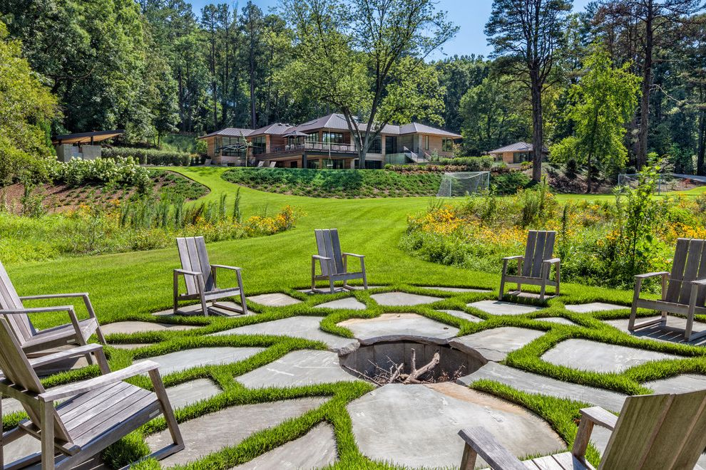 Landscape Supply Greenville Sc   Traditional Patio Also Backyard Retreat Built in Fire Pit Circular Seating Area Concrete Fire Pit Grass Landscape Lawn Modern Landscape Outdoor Chairs Seating Area Tree Yard