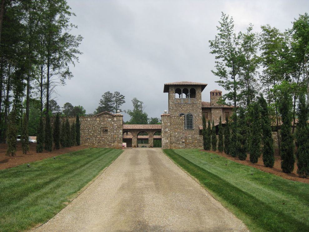 Landscape Supply Greenville Sc with Mediterranean Exterior  and Alle Arch Cypress Driveway Gate Entrance Entry Grass Gravel Driveway Lawn Rock Wall Tower Turf